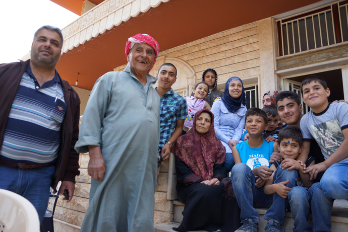 80 yo Mohhamed Hasan Kenaan and his family who survived the shelling. (Photo by Nadezhda Kevorkova)