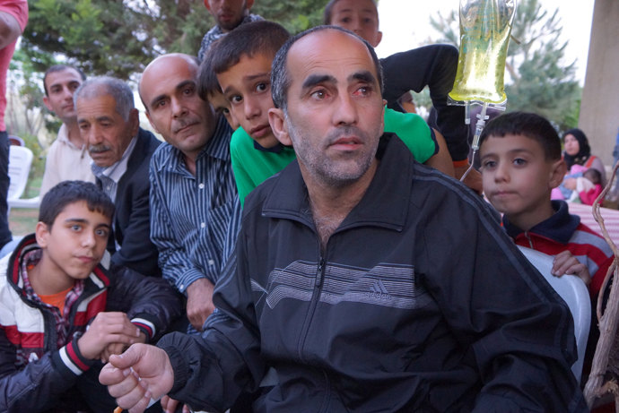 Truck driver Hussein Kemel Jafar was held captive 24 days. His eyes are red from the beating and torture. His family is proud that they too had captured five hostages, including the FSA militant. On the right - his youngest son, Nasrallah. If the Syrian war comes to Lebanon, people will be killed just because of their name. (Photo by Nadezhda Kevorkova)
