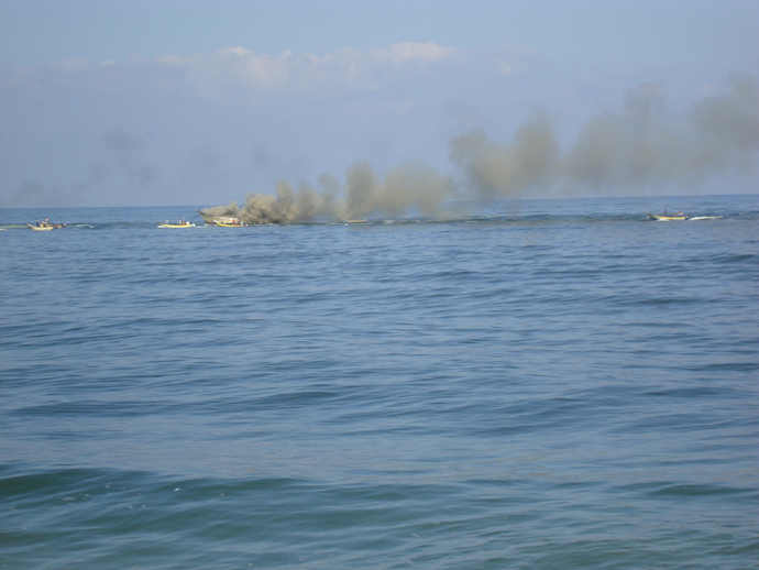 Palestinian boat attacked by Israeli gunboats with heavy machinegun fire and a missile, setting the boat aflame and completely destroying it, August 31, 2009. (Photo: Eva Bartlett/copyright RT)