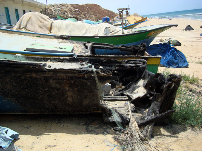 Wreckage of a Palestinian fishing boat destroyed by Israeli navy shelling. (Photo: Eva Bartlett/copyright RT)