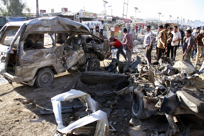 Residents gather at the site of a car bomb attack in Baghdad's Husseiniya district, April 25, 2013. (Reuters/Wissm al-Okili)