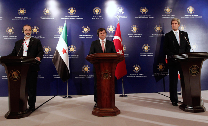 Turkish Foreign Minister Ahmet Davutoglu (C), U.S. Secretary of State John Kerry (R) and Syrian opposition leader Moaz al-Khatib attend a news conference after the Friends of Syria meeting in Istanbul April 20, 2013 (Reuters / Osman Orsal)