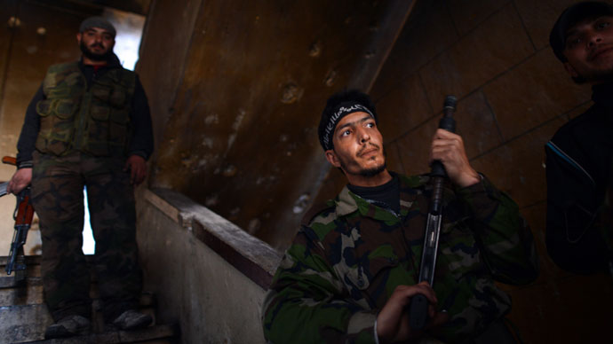 Syrian rebels take position inside a building in the Saif al-Dawla district of the northern Syrian city of Aleppo on April 5, 2013.(AFP Photo / Dimitar Dilkoff)