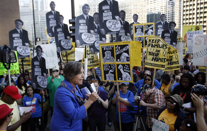 "U.S. Representative Jan Schakowksy (D-IL) speaks to members of a coalition called ""Stand up Chicago"" protest outside the Mortgage Bankers Association's annual meeting in Chicago October 10, 2011. (Reuters/Frank Polich)"