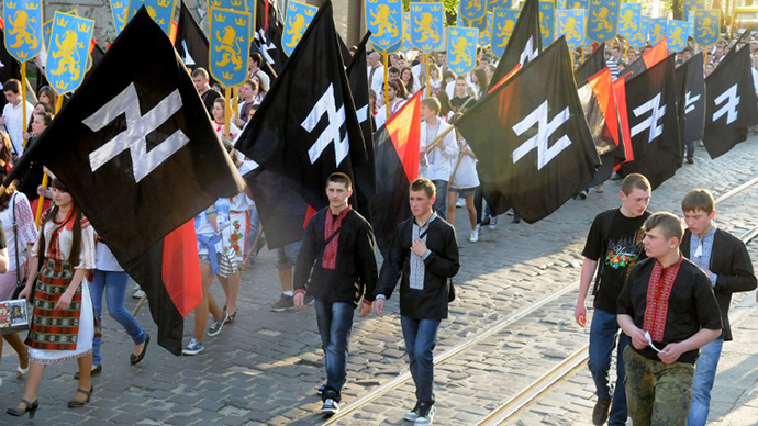 Supporters of the Ukrainian nationalist movement rally in downtown Lviv on April 28, 2012 to mark the 68th anniversary of the formation of the Ukrainian Galacian Division of the Waffen SS. (AFP Photo / Yuriy Dyachyshyn)