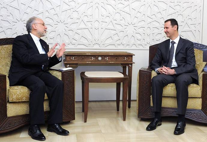 Syrian President Bashar al-Assad (right) meeting with Iranian Foreign Minister Ali Akbar Salehi on May 7, 2013 in the Syrian capital, Damascus. (AFP Photo / SANA)