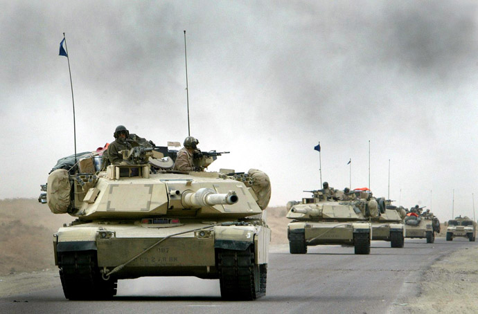 A convoy of US Army 3rd Infantry M1A1 Abrams tanks cross the Euphrates river as black smoke rises after an explosion as hundreds of armored vehicles push towards the outskirts of Baghdad on April 6, 2003. (Reuters)