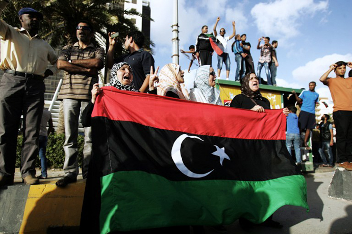 Libyan protestors shout political slogans as they call for the resignation of Benghazi's city council after a car bomb hit the eastern Libyan city earlier on May 13, 2013. (AFP Photo / Abdullah Doma)