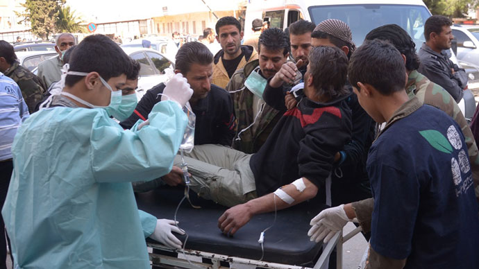 Man is brought to a hospital in the Khan al-Assal region in the northern Aleppo province, as Syria's government accused rebel forces of using chemical weapons for the first time. The opposition denied the claim, saying instead that government forces might have used banned weapons.(AFP Photo / HO-SANA)