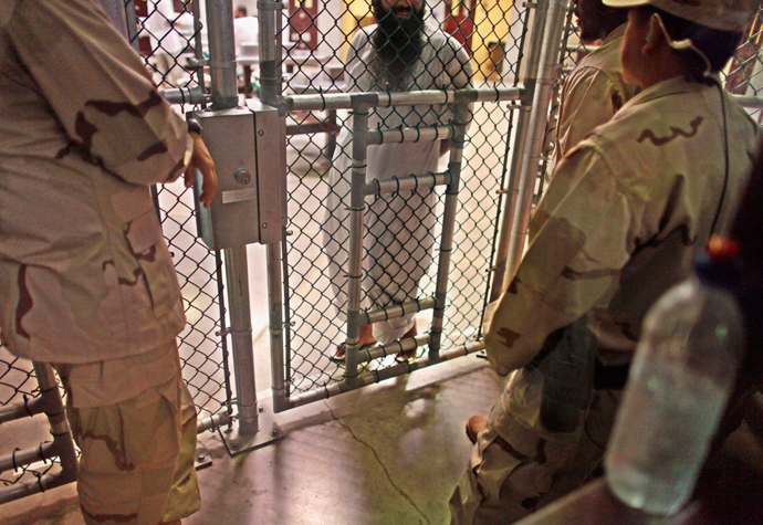 In this photo, reviewed by the U.S. military, a Guantanamo detainee speaks with guards inside the Camp 6 detention facility at Guantanamo Bay U.S. Naval Base in Cuba (Reuters / Brennan Linsley)