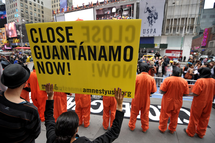 Activists demand the closing of the US military's detention facility in Guantanamo during a protest, part of the Nationwide for Guantanamo Day of Action, April 11, 2013 in New York's Times Square. (AFP Photo)