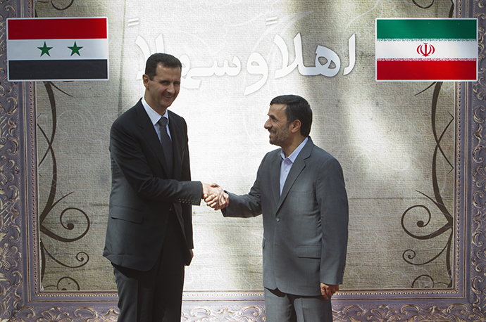 Iranian President Ahmadinejad shakes hands with his Syrian counterpart al-Assad during an official welcoming ceremony in Tehran on October 2, 2010. (Reuters / Morteza Nikoubazl)
