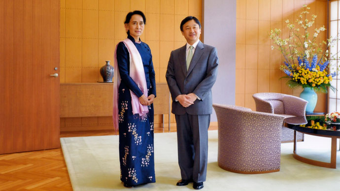 Nobel laureate and Myanmar opposition leader Aung San Suu Kyi (L) and Japanese Crown Prince Naruhito posing for photographers during their meeting at the latter's residence Togu Palace in Tokyo. Suu Kyi is on a week-long visit to Japan.(AFP Photo / Imperial Household Agency)