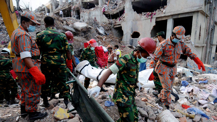 Rescue workers carry the remains of a garment worker retrieved from the rubble of the collapsed Rana Plaza building in Savar, 30 km (19 miles) outside Dhaka May 5, 2013.(Reuters / Stringer)