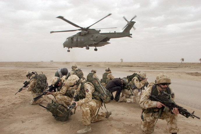British soldiers take position after descend from their helicopter during a security operation in the Iraqi southern city of Basra. (AFP Photo / Essam Al-Sudani)
