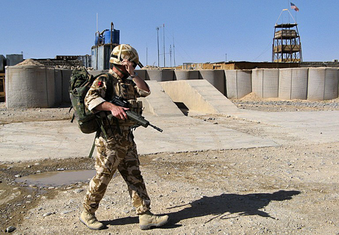 A British soldier with the NATO-led International Security Assistance Force (ISAF) walk at their base in Helmand province, Afghanistan. (AFP Photo / Abdul Malek)