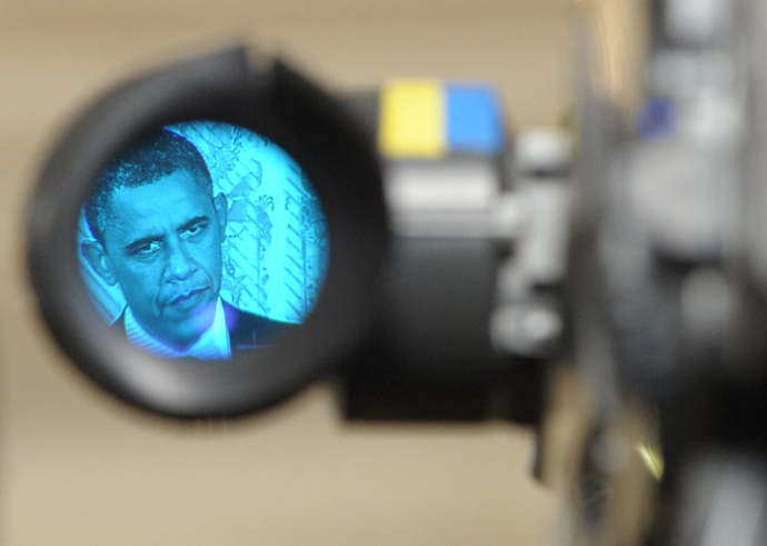 US President Barack Obama, as seen through the eyepiece of a television camera, speaks during a press conference in the East Room of the White House in Washington. (AFP Photo / Saul Loeb)