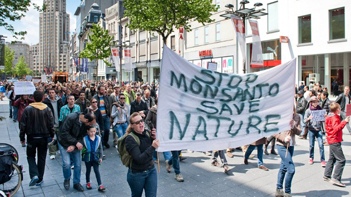 Protesters march on the Meir in Antwerp on May 25, 2013 during a protest against the American multinational agricultural biotechnology corporation Monsanto. (AFP Photo / Jonas Roosens)
