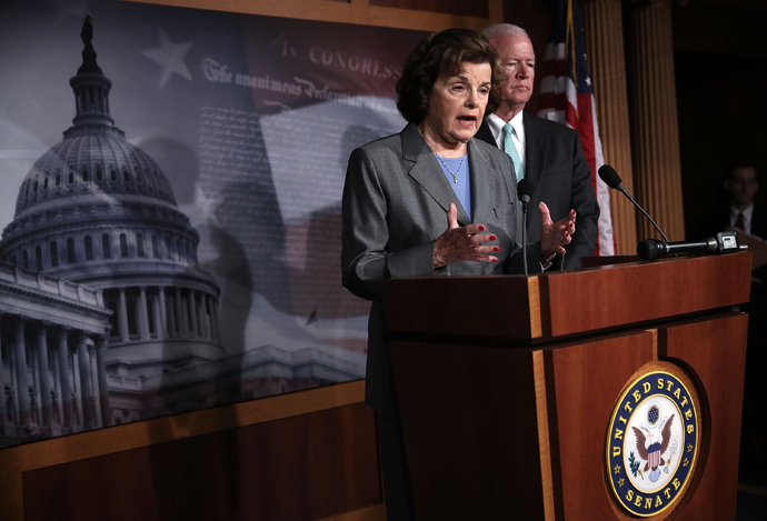 Chairman and Vice Chairman of the U.S. Senate Select Committee on Intelligence, Sen. Dianne Feinstein (D-CA) (L) and U.S. Sen. Saxby Chambliss (R-GA) (R), speak to members of the media about the National Security Agency (NSA) collevting phone records June 6, 2013 on Capitol Hill in Washington, DC (Alex Wong / Getty Images / AFP)