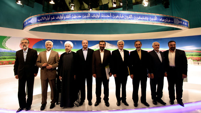 Iranian presidential candidates (L to R) former parliament speaker Gholam-Ali Haddad Adel, top nuclear negotiator Saeed Jalili, former chief nuclear negotiator Hassan Rowhani, Tehran's mayor Mohammad Baqer Qalibaf, former chief of the Revolutionary Guards Mohsen Rezai, former first vice president Mohammad Reza Aref, former foreign minister Ali Akbar Velayati, Mohammad Qarazi and state TV anchor Morteza Heidari pose for a group picture after a live debate on state TV in Tehran on June 7, 2013, ahead of the upcoming presidential elections.(AFP Photo / IRIB / Mehdi Dehghan)