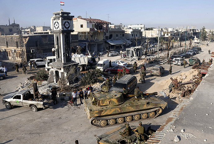 Syrian government forces and their Lebanese Hezbollah allies seized control of the border town of Qusair on June 5, 2013. (Reuters / Mohamed Azakir)