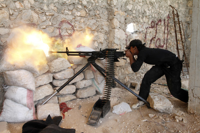 A Free Syrian Army fighter shoots his weapon near Kindi hospital, which is under the control of forces loyal to President Bashar Al-Assad, as both sides fight to take control of the hospital in Aleppo (Reuters/Hamid Khatib)