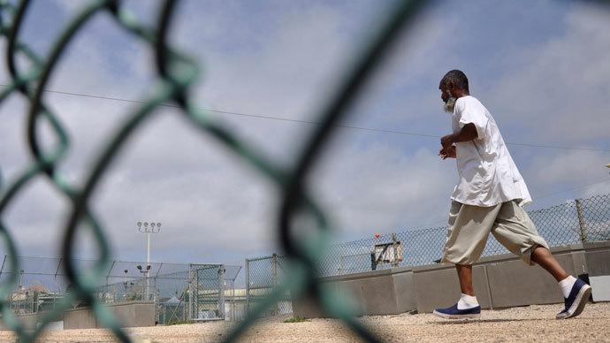 A Guantanamo detainee runs inside an exercise area at the detention facility at Guantanamo Bay US Naval Base, Cuba.(AFP Photo / Michelle Shephard)