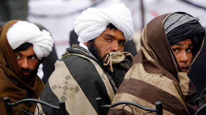 Afghan Taliban look on after handing over their weapons as they join the Afghan government's reconciliation and reintegration program in Herat province, February 17, 2013.(Reuters / Mohmmad Shoib)
