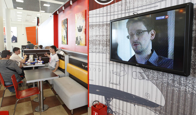 A television screen shows former U.S. spy agency contractor Edward Snowden during a news bulletin at a cafe at Moscow's Sheremetyevo airport June 26, 2013. (Reuters)