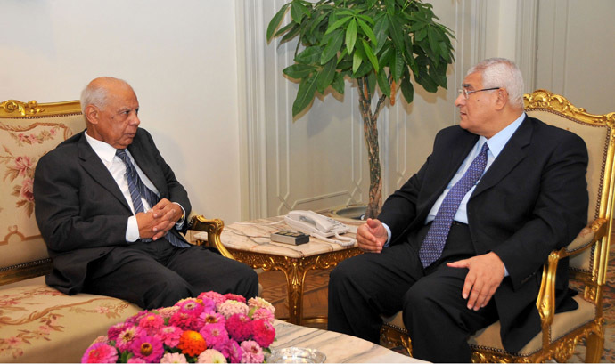 In this handout picture made available by the Egyptian presidency shows Egypt's interim president Adly Mansour (R) meeting with with new-appointed Prime Minister Hazem al-Beblawi, on July 9, 2013 in the Egyptian capital, Cairo (AFP Photo)