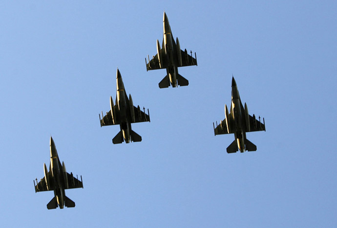 F-16 fighter jets (Reuters/Mike Blake)
