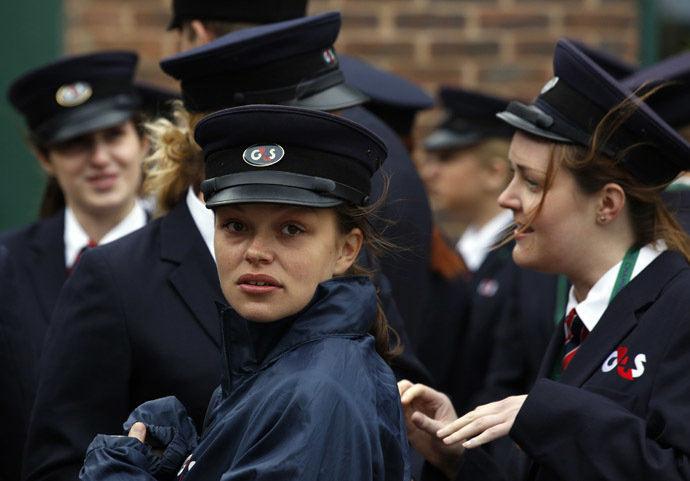 Security staff hired by multinational firm G4S are briefed a day before the start of the Wimbledon Tennis Championships in London June 23, 2013. (Reuters/Chris Helgren)