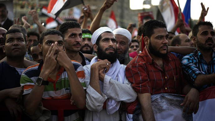 Muslim Brotherhood members and supporters of deposed president Mohammed Morsi take part in a rally outside Rabaa al-Adawiya mosque on July 15, 2013 in Cairo, Egypt. (Reuters / Gianluigi Guercia)