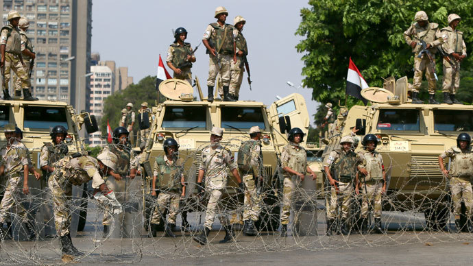 Egyptian army soldiers block Salah Salem highway to prevent supporters of the Muslim Brotherhood and ousted Egyptian president Mohamed Morsi from crossing during their demonstration in Cairo, on July 19, 2013.(AFP Photo / Marwan Naamani)