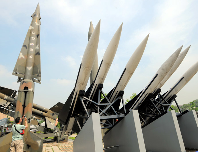 A visitor takes pictures of replicas of North Korea's Scud-B missile, (center green) and South Korean missiles that are displayed at the Korean War Memorial in Seoul on June 28, 2010. (AFP Photo)