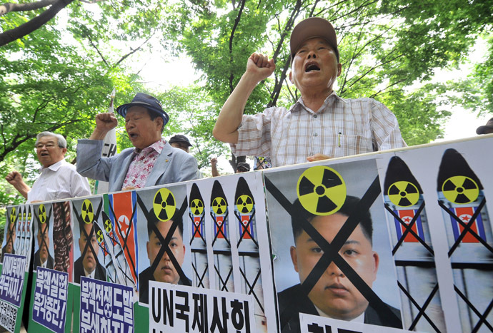 South Korean conservative activists hold placards showing portraits of North Korean leader Kim Jong-Un during an anti-Pyongyang rally to mark the 63th anniversary of the Korean War and denouncing North Korea's nuclear programs, in Seoul on June 24, 2013. (AFP Photo)