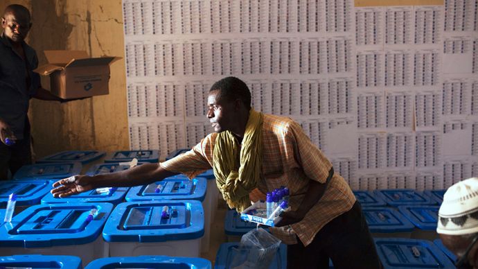 An electoral official arranges voting boxes in Timbuktu July 26, 2013 (Reuters / Joe Penney)