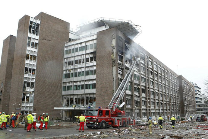Firefigthers work at the site of an explosion near government buildings in Norway's capital Oslo on July 22, 2011. (AFP Photo / Roald Berit)