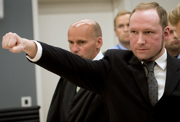 Self confessed mass murderer Anders Behring Breivik raises his fist in a right wing salute after being sentenced to 21 years in prison, in court room 250 at Oslo District Court on August 24, 2012. (AFP Photo / Odd Andersen)