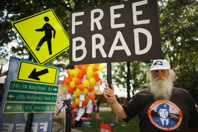 Supporters of U.S. Army Private First Class Bradley Manning protest his detention by marching around the perimeter and blocking the gates of Fort McNair on the final day of closing arguments in his military trial July 26, 2013 in Washington, DC. (AFP Photo / Chip Somodevilla)