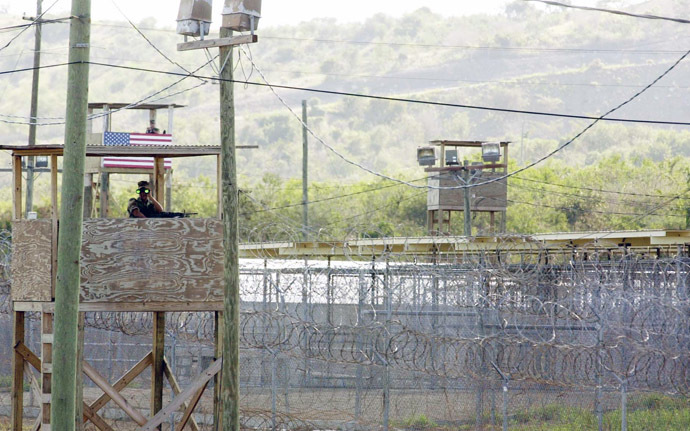 A US Marine manning an observation tower surveys the outside of Camp X-Ray where 110 Al-Qaeda and Taliban detainees are being currently held by US authorities at the US Guantanamo US Naval Base in Guantanamo Bay, Cuba (AFP Photo)