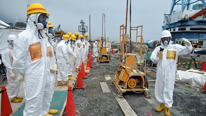 This photo taken on August 6, 2013 shows local government officials and nuclear experts inspecting a construction site to prevent the seepage of contamination water into the sea, at Tokyo Electric Power's (TEPCO) Fukushima Dai-ichi nuclear plant in Okuma, Fukushima prefecture. (AFP Photo / Jiji Press)