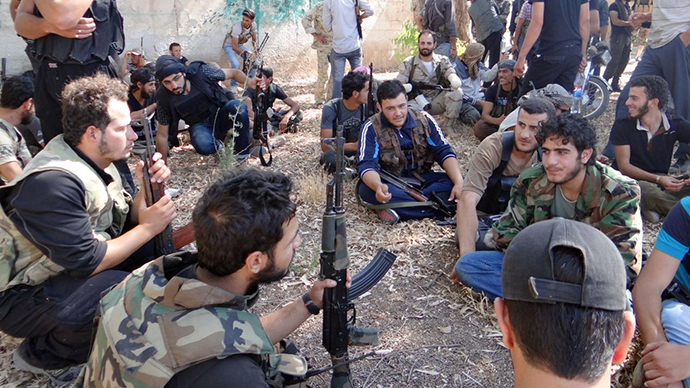 A handout image released by the Syrian opposition's Shaam News Network on July 30, 2013, shows rebel fighters gathered in the grounds of a school to receive instructions on July 27, 2013, the southern city Daraa. (AFP Photo)