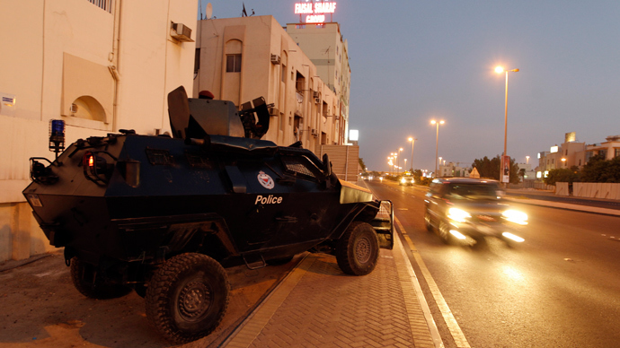 An armoured personnel carrier is seen by the side of a road during the early hours of the evening in Manama August 13, 2013 (Reuters / Hamad I Mohammed)