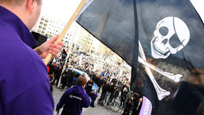 A supporter of file-sharing hub The Pirate Bay, waves a Jolly Roger flag during a demonstration in Stockholm.(Reuters / Fredrik Persson)