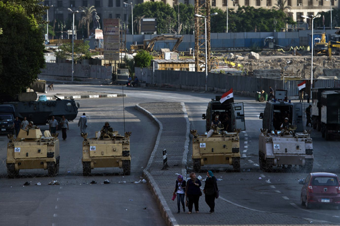 Egyptian army armoured personnel carriers (APC) are seen stationed in front of the Egyptian Museum in Tahrir Square on August 18, 2013 in Cairo. (AFP Photo)