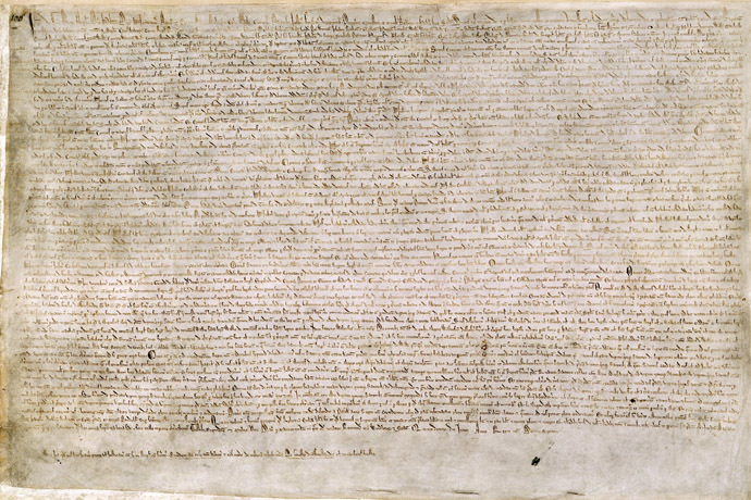 The Magna Carta (originally known as the Charter of Liberties) of 1215, written in iron gall ink on parchment in medieval Latin, using standard abbreviations of the period, authenticated with the Great Seal of King John. The original wax seal was lost over the centuries. This document is held at the British Library and is identified as The British Library, Cotton MS. Augustus II. 106. (Photo from wikipedia.org)