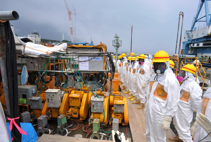This photo taken on August 6, 2013 shows local government officials and nuclear experts inspecting a facility to prevent seeping of contamination water into the sea at Tokyo Electric Power's (TEPCO) Fukushima Dai-ichi nuclear plant (Japan out AFP Photo / Japan Pool via JIJI Press)