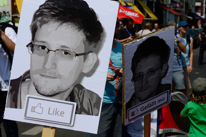 Demonstrators hold placards featuring an image of former US intelligence contractor Edward Snowden as they take part in a protest against the US National Security Agency (AFP Photo / John Macdougall)