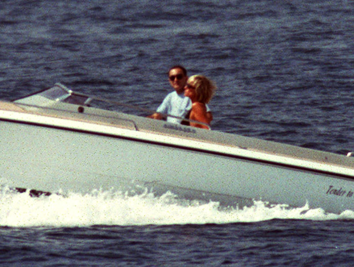 A couple identified as Diana Princess of Wales and Egyptian businessman Dodi Al Fayed cruise off the coast of Saint Tropez, Southern France, August 22. Lady Diana is in Saint Tropez on her fourth summer holiday in six weeks. (Reuters)